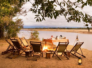 Drinks by the river at Island Bush Camp